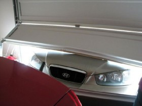 car that has driven through a garage door