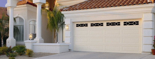 Cream Two Car Garage Door in Spanish Style Home