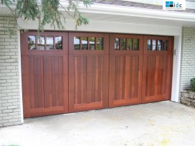 Four Red Wood Garage Doors with Glass Panels