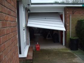 warped garage door
