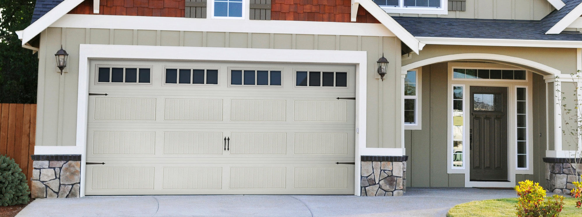Grey Home With Matching Garage Door