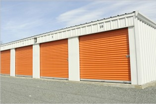 orange garage doors on storage unit