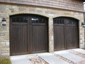 Garage with Dark Brown Doors and Stone Border