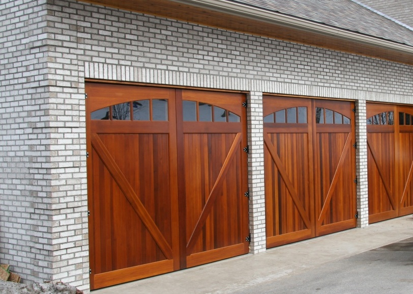 Great Three Car Garage Doors With Red Wood Double Doors