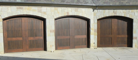 Three Dark Brown Wood Double Garage Doors