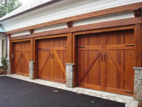Three Red Wooden Double Garage Doors