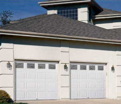 Two Car Garage Doors With Large Cream Stone Columns