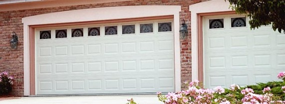 Two Garage Doors With Pink Border and Styled Glass