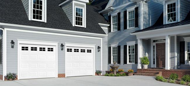 gallery austin garage door solutionstwo white garage doors
