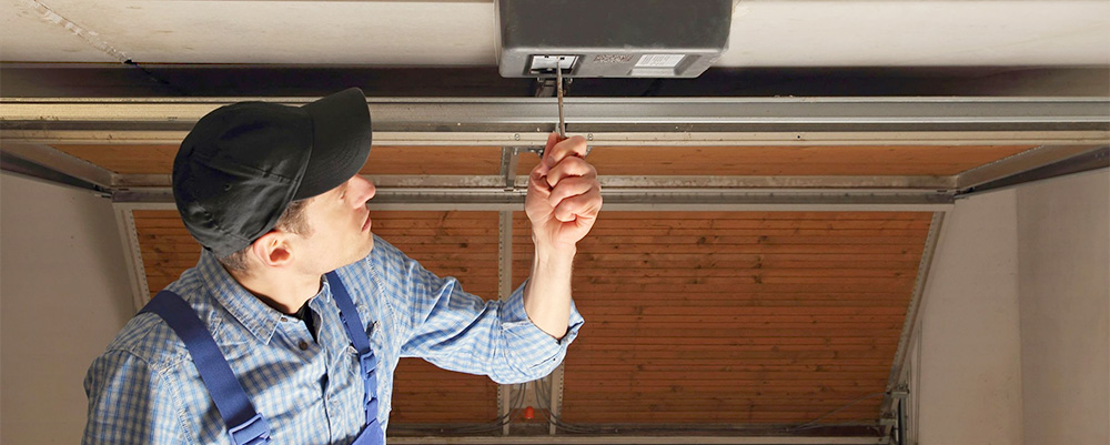 man checking garage door opener