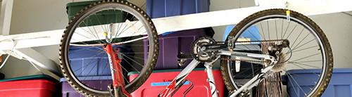Bike hanging from bike rack hooks