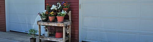 Potting bench in front of twin garage doors