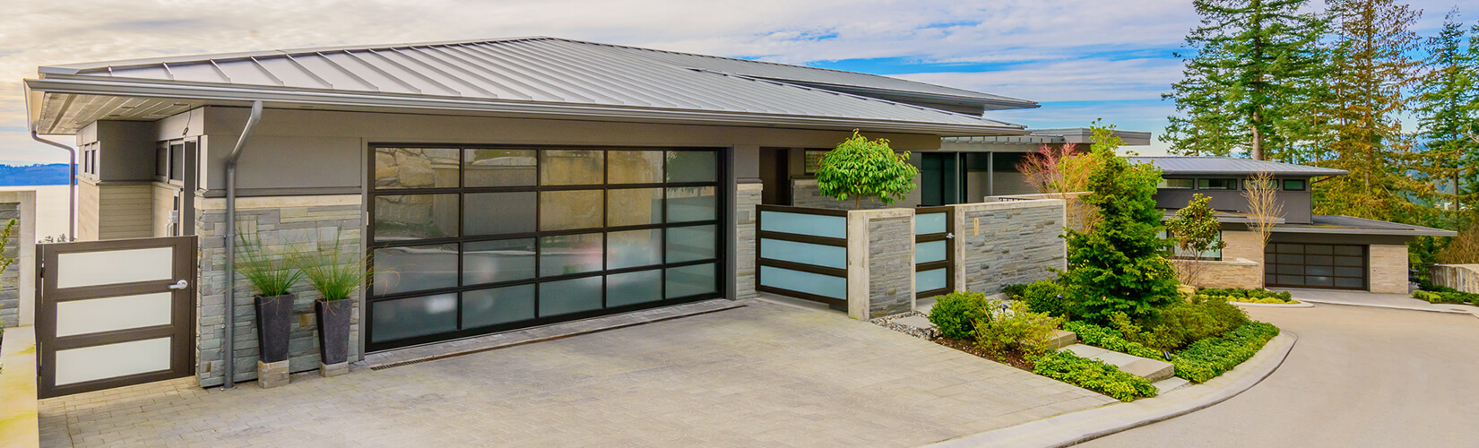 Grey modern home with glass garage door